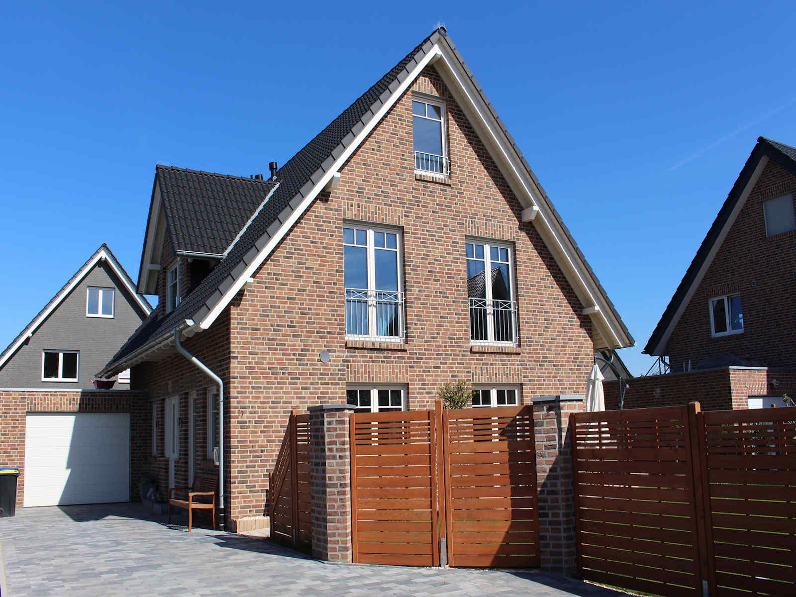 Holzhaus mit Klinkerfassade