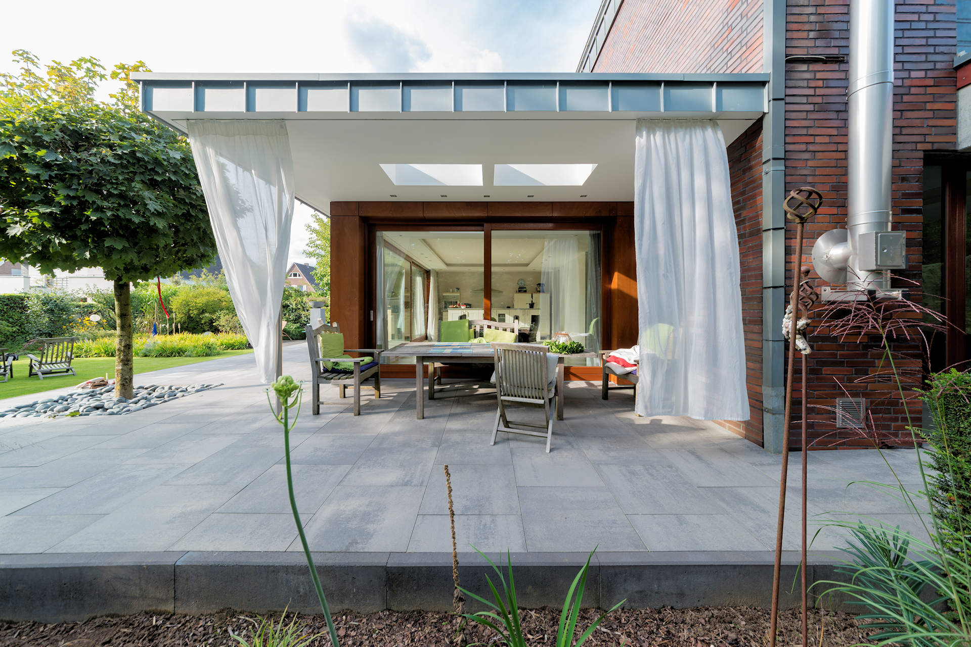 Wohnraumerweiterung mit Terrassenüberdachung